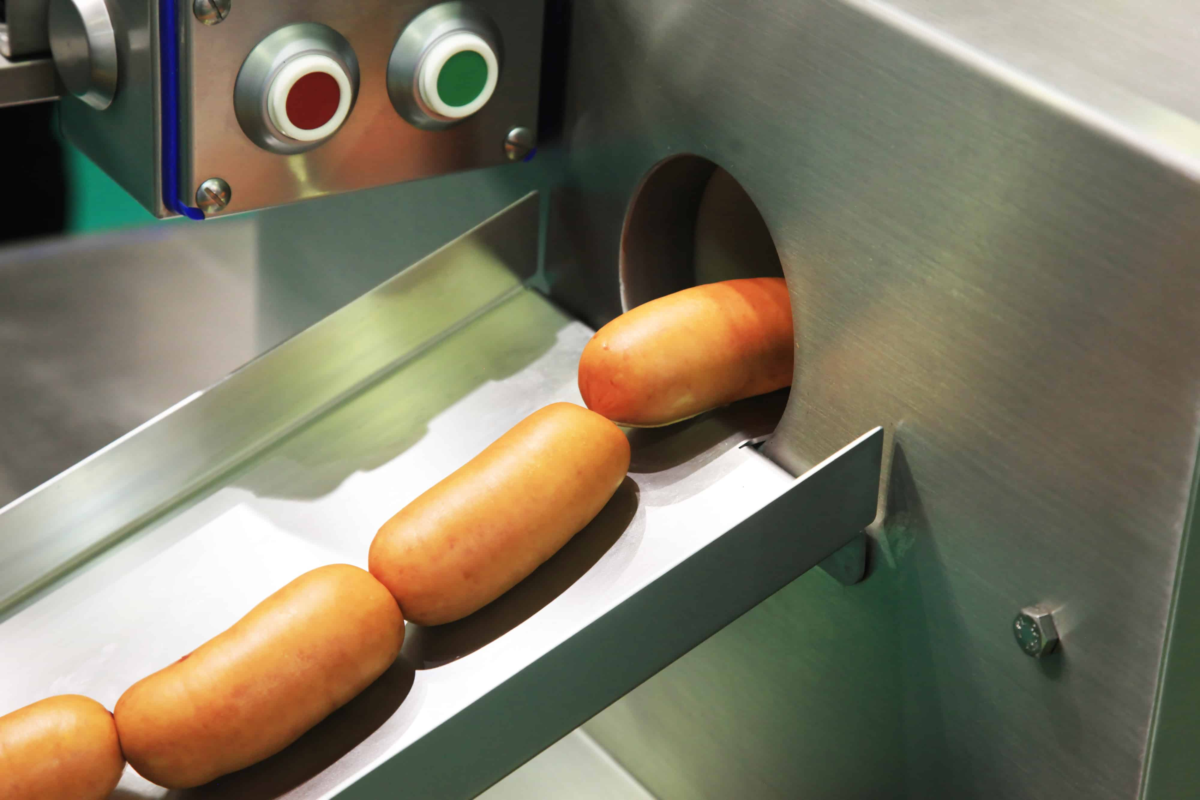 Ready-made pork sausages in a molding machine